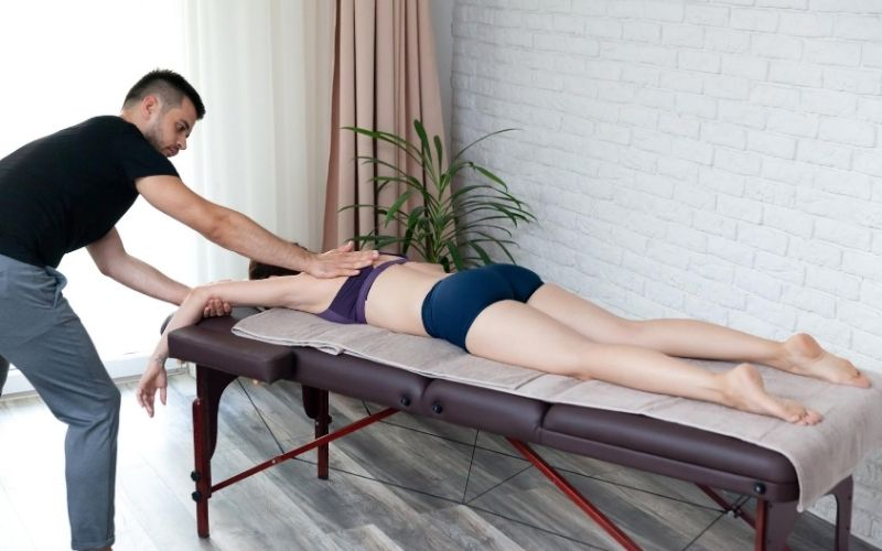 Woman laying on table getting at-home chiropractic care.