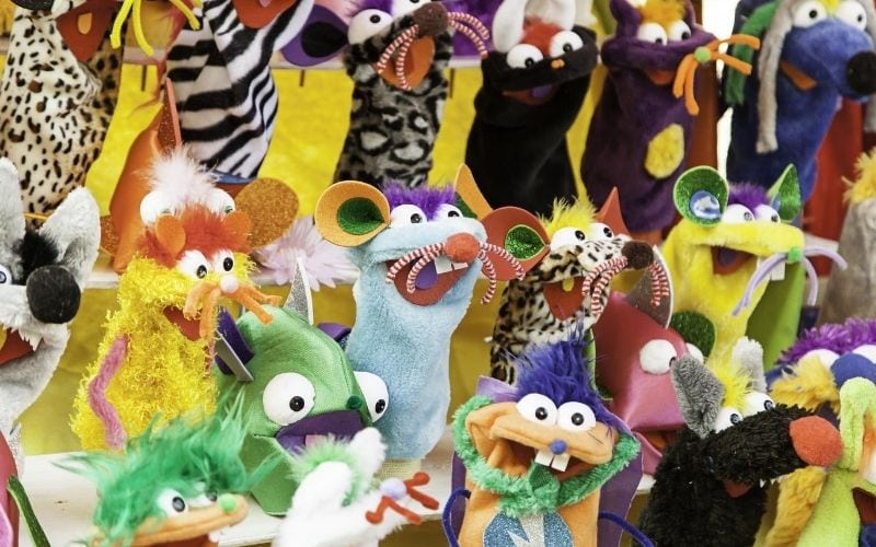 Photo of many different puppets.
