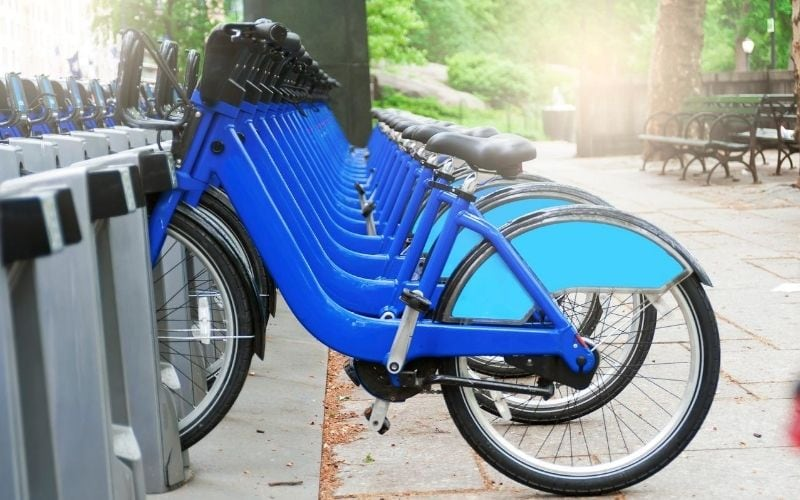 Ble city bikes on their rack.