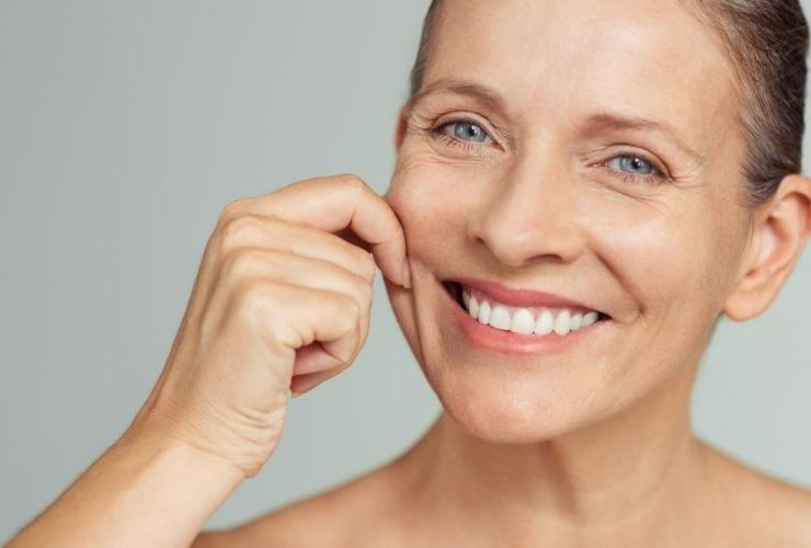 Woman showing her beautiful skin smiling.