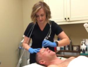 Tonya Grismer L.M.E. exfoliates David's skin to prep it for the Hyaluronic Acid.