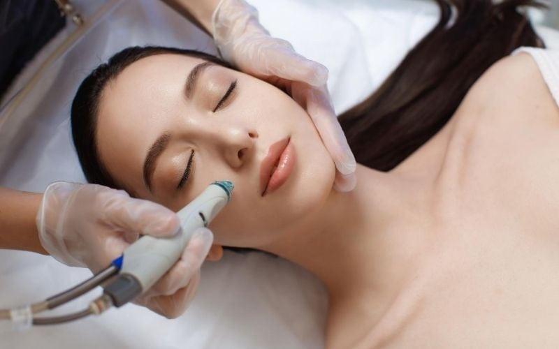 Woman getting a hydra facial treatment.