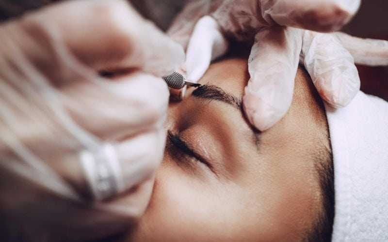 Woman getting microblading done.