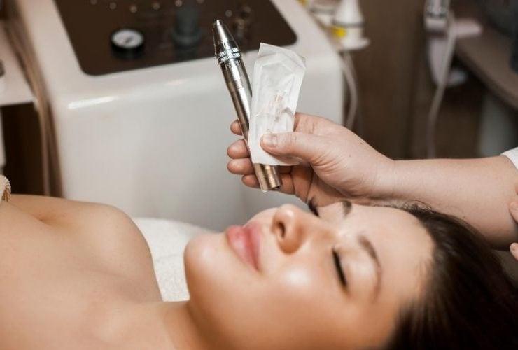 Woman getting micro needling treatment.