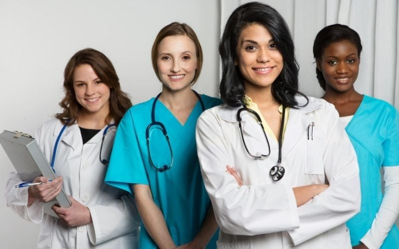 Woman doctors standing together.