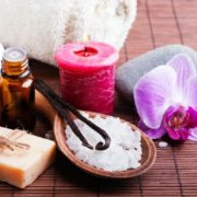 Spa products on brown, wood table.