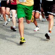 People running in 5K race.