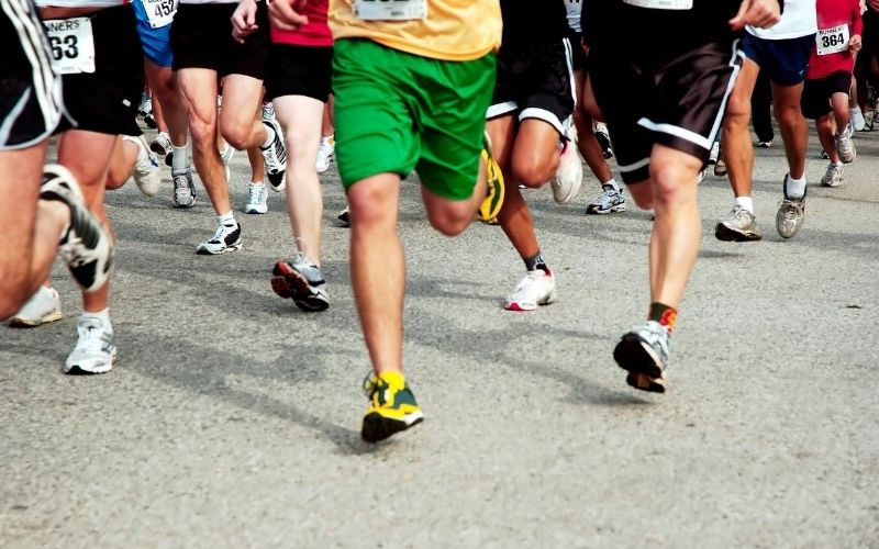 People running in 5K race.
