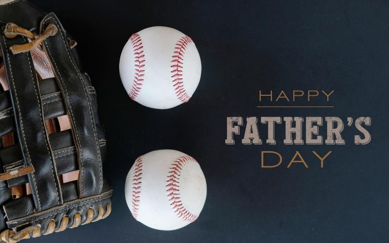 """""""Happy Fathers Day"""" sign with two baseballs and a glove,"""