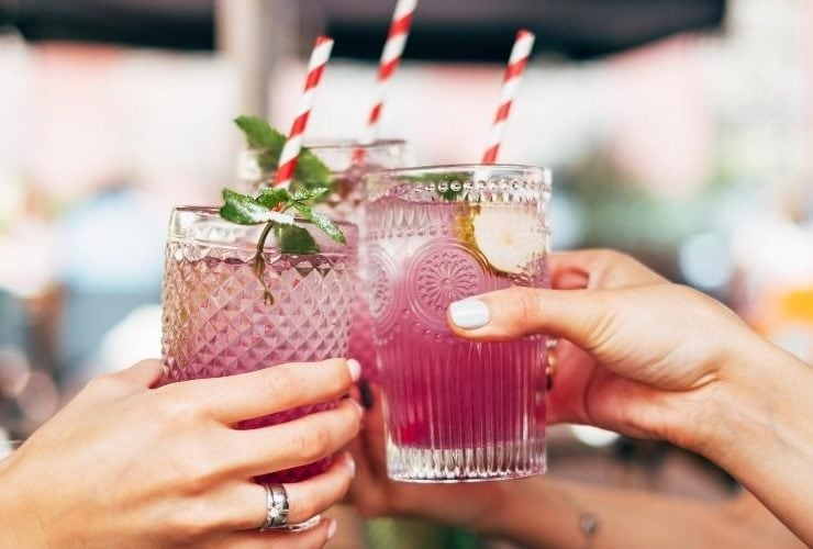 Cheers-ing with handcrafted cocktails.