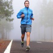 Man running on foggy day.