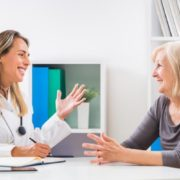 Women discussing with her female doctor.