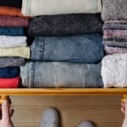 Open drawer full of organized clothing.