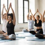 Woman leading yoga class.