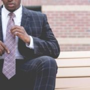 Man sitting down in nice suit.