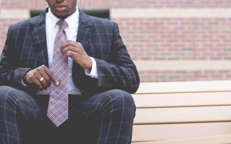 Man sitting down in nice suit.