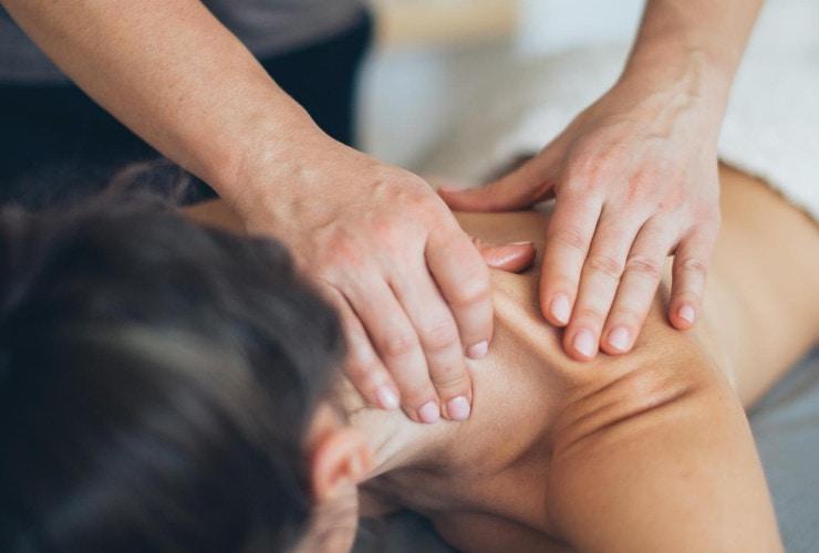 Woman getting a neck massage.