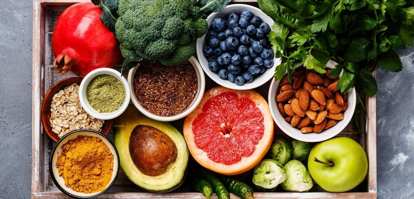 A tray of healthy, colorful fruits and vegetables.