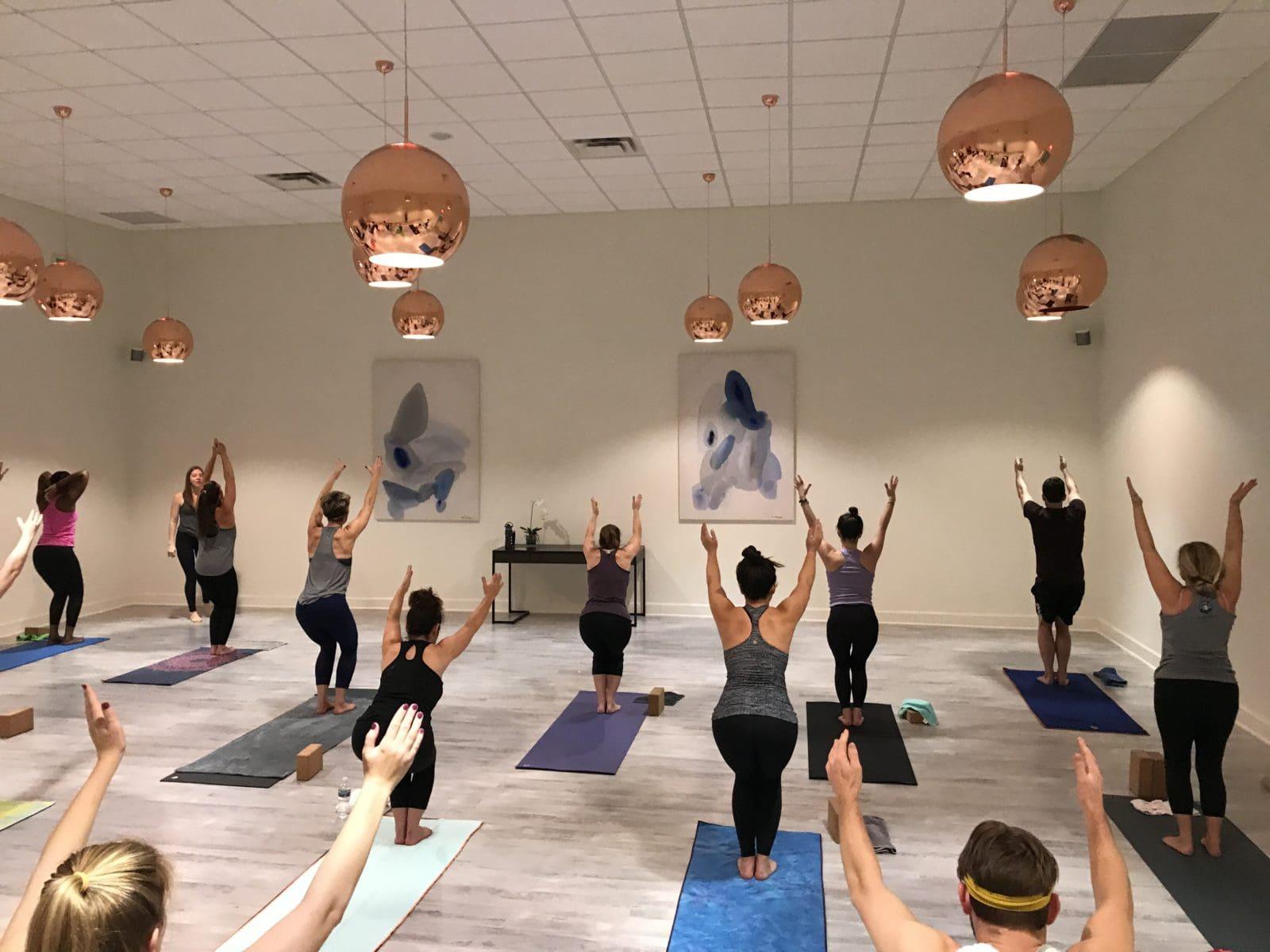 People taking a yoga class.