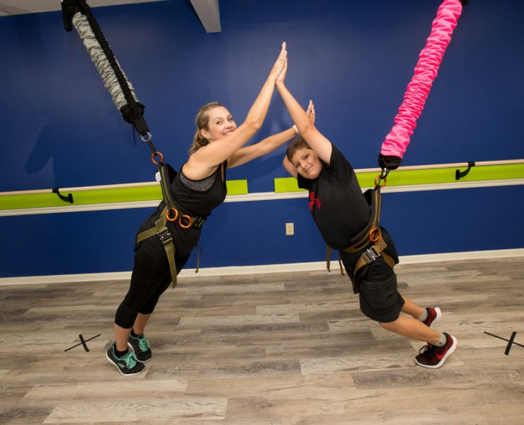 Two students trying out Studio Bungee- a bungee resistance training workout class in Atlanta.