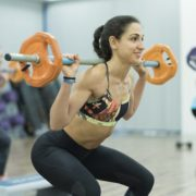 """People doing """"Body Pump"""" workout with dumbells."""