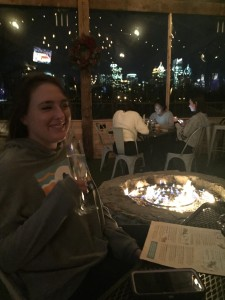 Enjoying a free glass of champagne by the fire after class.
