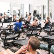 Women and men on megareformers at Stellar Bodies gym in Atlanta.