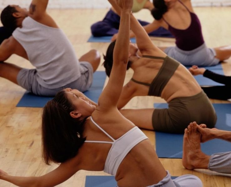 Students stretching during yoga class.