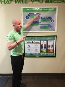 Owner Mike Prosnick explains a JAM Fitness challenge