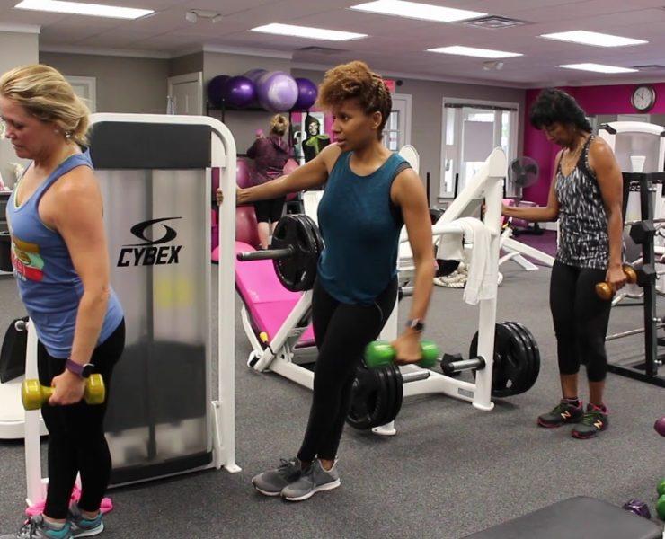 Women using workout equipment at Atlanta Fitness Diva's gym.