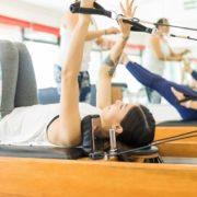 Women taking a pilates class on megaformers.
