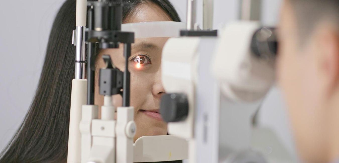 Woman getting an eye exam.
