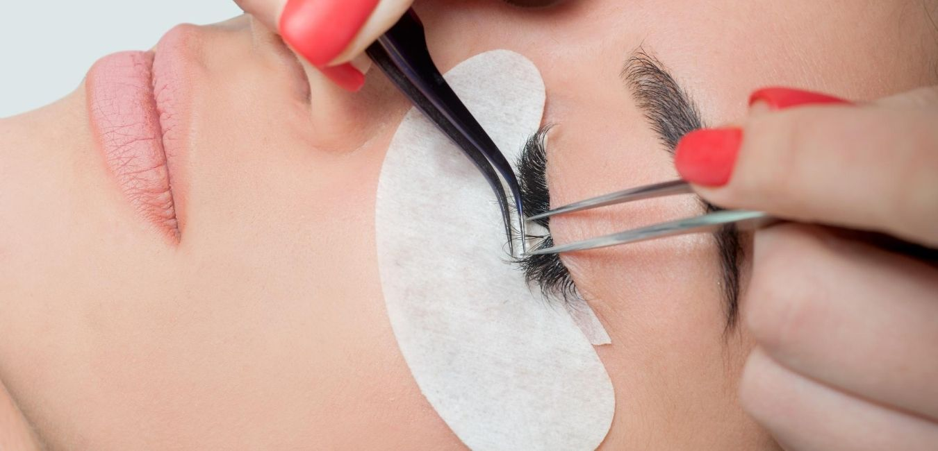 Woman getting lash extensions.