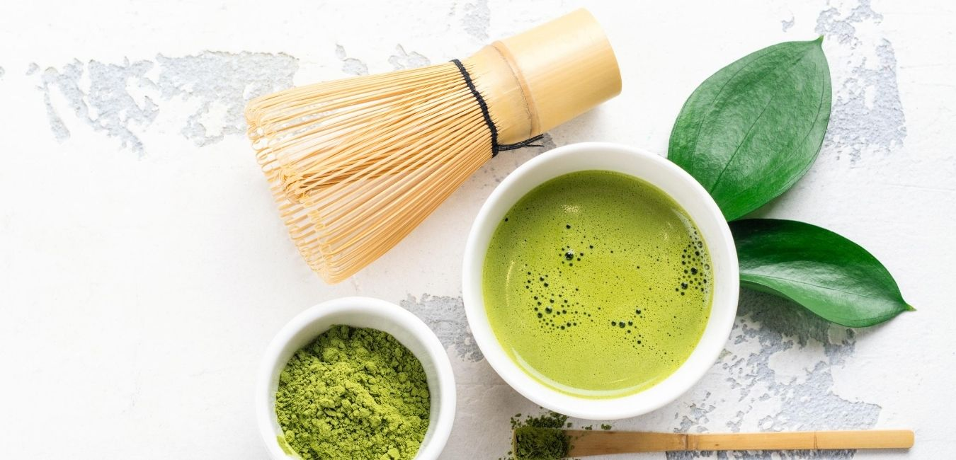 A photo of a warm, green drink called matcha.