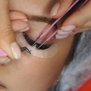 Woman getting professional lash extensions.