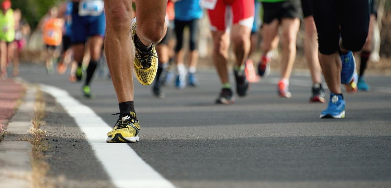 People running on road.