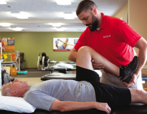 A BenchMark PT helping a patient through Manual Therapy
