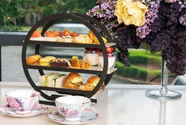Tea setting with cups and sandwich stand