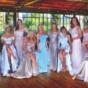 10 Over 40 & Fab Winners stand in sit in formal dresses for a group photo