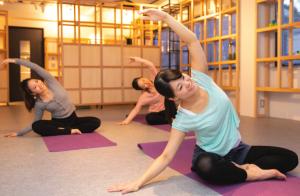 Women stretching in a yoga class.
