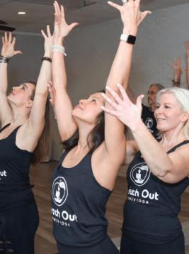 Karen Patton adjusts at yoga pose