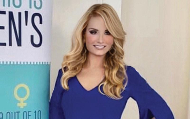 Kim Vaughn wearing a blue long-sleeved dress