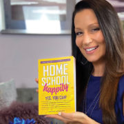Laura Kronen shows off her new book, Home School Happily Yes You Can!
