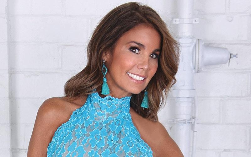 Nova Kopp smiles beautifully as she poses in a blue sleeveless dress