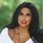 Beautiful smiling woman wearing a white blouse