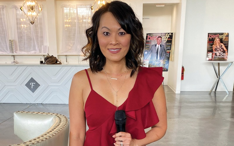 Tran Bui Smith wearing a burgundy jumpsuit
