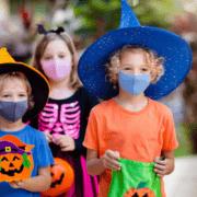 Kids with masks on Halloween