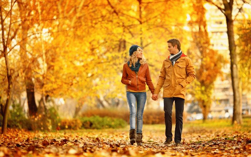 Couple walking in fall park