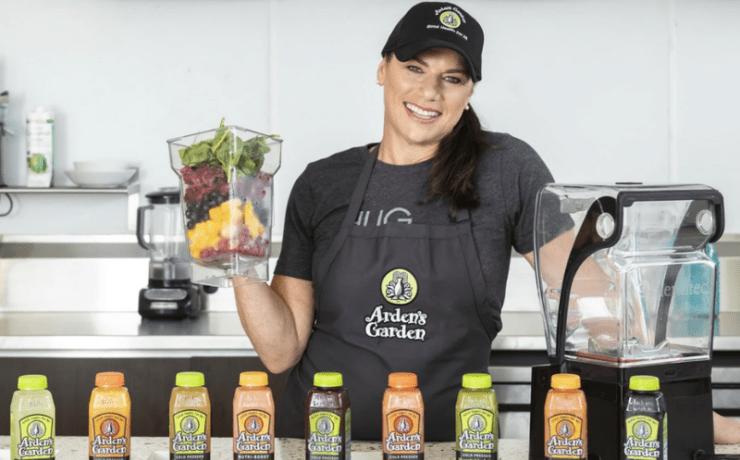 Arden Zinn in front of her juices