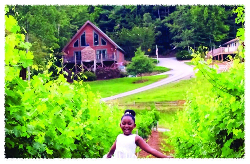 Little girl running in a vineyard, Paradise Hills